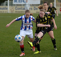 20140315 - WESTERLO , BELGIUM : Heerenveen Sisca Folktersma (l) pictured in a duel with Lierse Silke Leynen (r) during the soccer match between the women teams of SK Lierse Dames  and SC Heerenveen Vrouwen , on the 19th matchday of the BeNeleague competition Saturday 15 March 2014 in Westerlo . PHOTO DAVID CATRY