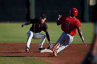 AZL Giants Black shortstop Dilan Rosario (18) prepares to catch a throw from the catcher on a stolen base attempt by Drevian Williams-Nelson (6) during an Arizona League game against the AZL Angels at the Giants Baseball Complex on June 21, 2019 in Scottsdale, Arizona. AZL Angels defeated AZL Giants Black 6-3. (Zachary Lucy/Four Seam Images)