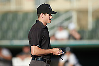 Umpire Nolan Early prior to the start of the South Atlantic League game between the Augusta GreenJackets and the Kannapolis Intimidators at Kannapolis Intimidators Stadium on June 21, 2019 in Kannapolis, North Carolina. The Intimidators defeated the GreenJackets 6-1. (Brian Westerholt/Four Seam Images)
