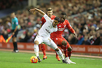 Kyle Naughton competes with Christian Benteke during the Barclays Premier League Match between Liverpool and Swansea City played at Anfield, Liverpool on 29th November 2015