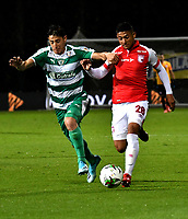 BOGOTÁ-COLOMBIA, 06-10-2019: Pablo Lima de La Equidad y Edwin Herrera de Independiente Santa Fe disputan el balón durante partido entre La Equidad y el Independiente Santa Fe de la fecha 15 por la Liga Águila II 2019, jugado en el estadio Metropolitano de Techo en la ciudad de Bogotá. / Pablo Lima of La Equidad and Edwin Herrera of Independiente Santa Fe vies for the ball, during a match between La Equidad and Independiente Santa Fe, of the 15th date for the Liga Aguila II 2019 at the Metropolitano de Techo stadium in Bogota city. / Photo: VizzorImage  / Luis Ramírez / Staff.