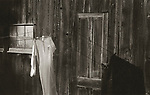 Scan from vintage print. Outdoor shed with clothesline and nightgown drying. Negative file# 75-242. 1975