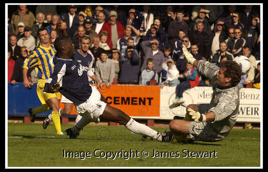31/8/02       Collect Pic : James Stewart                     .File Name : stewart-falkirk v qots 10.COLLIN SAMUEL FORCES THE BALL UNDER ANDY GORAM TO SCORE FALKIRK'S THIRD GOAL....James Stewart Photo Agency, 19 Carronlea Drive, Falkirk. FK2 8DN      Vat Reg No. 607 6932 25.Office : +44 (0)1324 570906     .Mobile : + 44 (0)7721 416997.Fax     :  +44 (0)1324 570906.E-mail : jim@jspa.co.uk.If you require further information then contact Jim Stewart on any of the numbers above.........