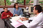 doctor in office consulting with mother and 12 year old boy