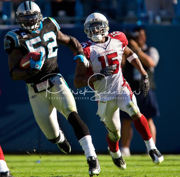 Carolina Panthers linebacker Jon Beason (52) runs past Arizona Cardinals wide receiver Steve Breaston (15) during an NFL football game at Bank of America Stadium in Charlotte, NC.