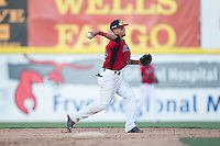 Hickory Crawdads second baseman Carlos Arroyo (25) makes a throw to first base against the Savannah Sand Gnats at L.P. Frans Stadium on June 14, 2015 in Hickory, North Carolina.  The Crawdads defeated the Sand Gnats 8-1.  (Brian Westerholt/Four Seam Images)