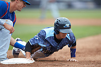 Cole Peterson (19) of the West Michigan Whitecaps dives head first back into first base as Jared Young (16) of the South Bend Cubs applies a tag at Fifth Third Ballpark on June 10, 2018 in Comstock Park, Michigan. The Cubs defeated the Whitecaps 5-4.  (Brian Westerholt/Four Seam Images)