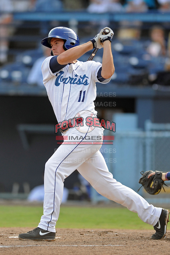 Asheville Tourists third baseman Jason Stolz #11 swings at a pitch during game one of a double header against the Rome Braves  at McCormick Field on June 4, 2013 in Asheville, North Carolina. The Braves won the game 5-3. (Tony Farlow/Four Seam Images)