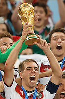 Philipp Lahm of Germany lifts the World Cup trophy after winning the 2014 final