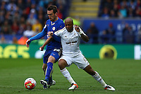 Christian Fuchs of Leicester City and Andre Ayew of Swansea City during the Barclays Premier League match between Leicester City and Swansea City played at The King Power Stadium, Leicester on 24th April 2016