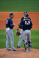 San Antonio Missions manager Jamie Quirk (9) makes a pitching change with Trea Turner (4) and Jason Hagerty (22) during a game against the NW Arkansas Naturals on May 31, 2015 at Arvest Ballpark in Springdale, Arkansas.  NW Arkansas defeated San Antonio 3-1.  (Mike Janes/Four Seam Images)
