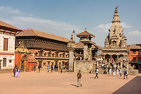 Bhaktapur, Nepal.  Durbar Square, Palace of 55 Windows on Left, with Golden Gate Entrance to Palace Grounds.  Vatsala Durga Temple on right.  The temple was completely destroyed in the earthquake of April 2015.