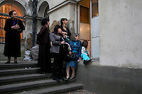 Parents watch their children at a dance rehearsal at the School of Youth Culture in Tbilisi...