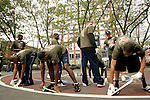(L to R) Gary Johnson, Corey Stokes and Anthony Randolph tape off the 3-point line on a basketball court in New York City as other high school basketball standouts look on as part of their volunteer service on August 31, 2006.  The players were in town for the Elite 24 Hoops Classic, which brought together the top 24 high school basketball players in the country regardless of class or sneaker affiliation.