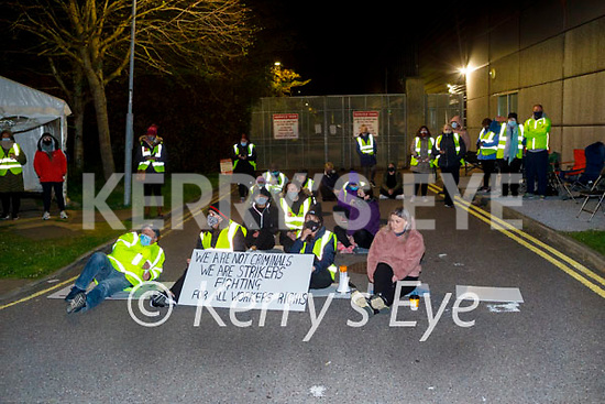 Ex Debenham staff hold a sit down protest at the rear entrance to Debenhams as the trucks arrived to remove stock in the early hours of Saturday morning.