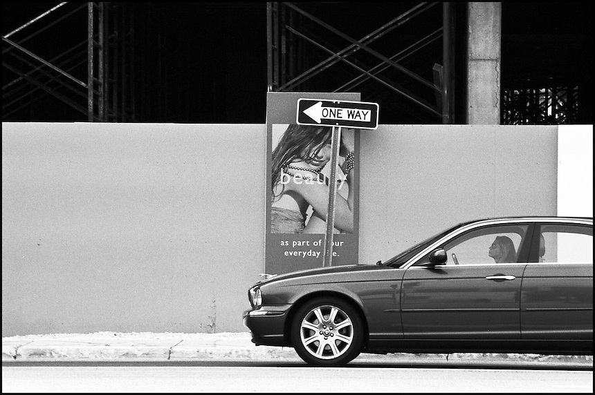 "From ""Walking Downtown"" series. Collins avenue, Sunny Isles Beach, FL"
