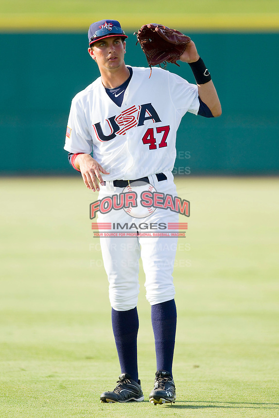 Vahn Bozoian #47 of the USA 18u National Team throws in the outfield prior to the game against the USA Baseball Collegiate National Team at the USA Baseball National Training Center on July 2, 2011 in Cary, North Carolina.  The College National Team defeated the 18u team 8-1.  Brian Westerholt / Four Seam Images