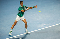 12th February 2021, Melbourne, Victoria, Australia; Novak Djokovic of Serbia returns the ball during round 3 of the 2021 Australian Open on February 12 2020, at Melbourne Park in Melbourne, Australia.