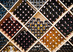 Wines displayed for sale behind the register at The Williamsburg Winery are stored in a pattern of inward- and outward-facing bottles.