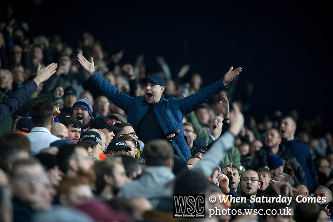 Home supporters reacting with delight to their team's second goal in the second-half as West Bromwich Albion take on Leeds United in a SkyBet Championship fixture at the Hawthorns. Formed in 1878, the home team were relegated from the English Premier League the previous season and were aiming to close the gap on the visitors at the top of the table. Albion won the match 4-1 watched by a near-capacity crowd of 25,661.