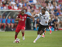 Commerce City, CO - Thursday June 08, 2017: Darlington Nagbe, Khaleem Hyland during a 2018 FIFA World Cup Qualifying Final Round match between the men's national teams of the United States (USA) and Trinidad and Tobago (TRI) at Dick's Sporting Goods Park.