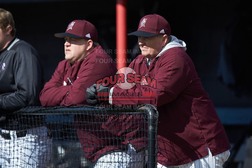 Bellarmine Knights head coach Larry Owens (right) watches from the dugout during the game against the North Greenville Crusaders at Ashmore Park on February 7, 2020 in Tigerville, South Carolina. The Crusaders defeated the Knights 10-2. (Brian Westerholt/Four Seam Images)