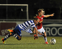 20130906 - OOSTAKKER , BELGIUM : PSV's Danielle Van de Donk (right)  pictured pulling down Gent's Margaux Van Ackere during the female soccer match between AA Gent Ladies  and PSV / FC Eindhoven Dames , of the third matchday in the BENELEAGUE competition. Friday 06 th September 2013. PHOTO DAVID CATRY