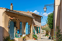 Gassin ancient typical Mediterranean village street and colorful houses, on the hills above the gulf of Saint-Tropez, France Azure Coast France