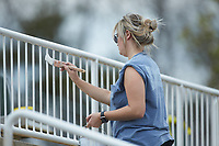 Caitlyn Gardner paints the railings at Intimidators Stadium in preparation for the 2019 Kannapolis Intimidators season during the NCAA baseball game between the Mars Hill Lions and the Queens Royals on March 30, 2019 in Kannapolis, North Carolina. The Royals defeated the Bulldogs 11-6 in game one of a double-header. (Brian Westerholt/Four Seam Images)