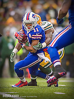 14 December 2014: Buffalo Bills running back Marcus Thigpen returns a 38-yard punt in the first quarter against the Green Bay Packers at Ralph Wilson Stadium in Orchard Park, NY. The Bills defeated the Packers 21-13, snapping the Packers' 5-game winning streak and keeping the Bills' 2014 playoff hopes alive. Ed Wolfstein Photo. Original shot Nikon D4 RAW (NEF)