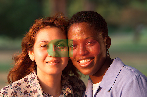 portrait of two young smiling women (DEPICTION OR IMPLICATION AS A LESBIAN COUPLE IS STRICTLY PROHIBITED)
