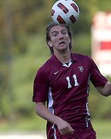 Harvard University forward Brian Rogers (11) heads the ball. Boston College defeated Harvard University, 2-0, at Newton Campus Field, October 11, 2011.