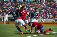 Orlando, Florida - Saturday, June 04, 2016: Paraguayan defender Bruno Valdez (5) attempts to play the ball while Costa Rican defender Ronald Matarrita (22) falls on the ground during a Group A Copa America Centenario match between Costa Rica and Paraguay at Camping World Stadium.