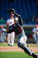 Louisville Cardinals catcher Zeke Pinkham (11) attempting to catch a foul ball popup during a game against the Ball State Cardinals on February 19, 2017 at Spectrum Field in Clearwater, Florida.  Louisville defeated Ball State 10-4.  (Mike Janes/Four Seam Images)