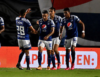 BOGOTA - COLOMBIA, 27-11-2020: Ricardo Marquez de Millonarios F. C. celebra con sus compañeros de equipo despues de anotar el primer gol a Once Caldas, durante partido entre Millonarios F. C. y Once Caldas de la fecha 1 por la Liguilla BetPlay DIMAYOR 2020 jugado en el estadio Nemesio Camacho El Campin de la ciudad de Bogota. / : Ricardo Marquez of Millonarios F. C. celebrates with his teammates after scoringthe first goal to Once Caldas, during a match between Millonarios F. C. and Once Caldas of the 1st date for the BetPlay DIMAYOR 2020 Liguilla played at the Nemesio Camacho El Campin Stadium in Bogota city. / Photo: VizzorImage / Luis Ramirez / Staff.