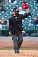 Home plate umpire Jim Garman signals that he needs two new baseballs during the game between the Sam Houston State Bearkats and the Texas Christian Horned Frogs at Minute Maid Park on February 28, 2014 in Houston, Texas.  The Bearkats defeated the Horned Frogs 9-4.  (Brian Westerholt/Four Seam Images)