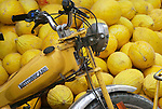 A yellow motorcycle blends in with yellow squash, Morocco