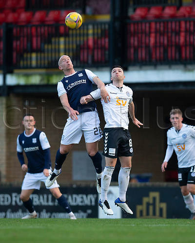 21st November 2020; Somerset Park, Ayr, South Ayrshire, Scotland; Scottish Championship Football, Ayr United versus Dundee FC; Charlie Adam of Dundee competes in the air with Michael Miller of Ayr United