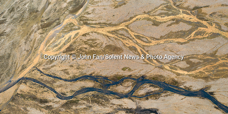 Aerial photographs of glacial streams show off their fascinating colours and patterns.  The shots, taken in Icelandic valleys, look more like abstract artworks than landscapes.<br /> <br /> Amateur photographer John Fan, from Chicago, USA, used a drone to capture these shots of glacial streams.  SEE OUR COPY FOR DETAILS.<br /> <br /> Please byline: John Fan/Solent News<br /> <br /> © John Fan/Solent News & Photo Agency<br /> UK +44 (0) 2380 458800