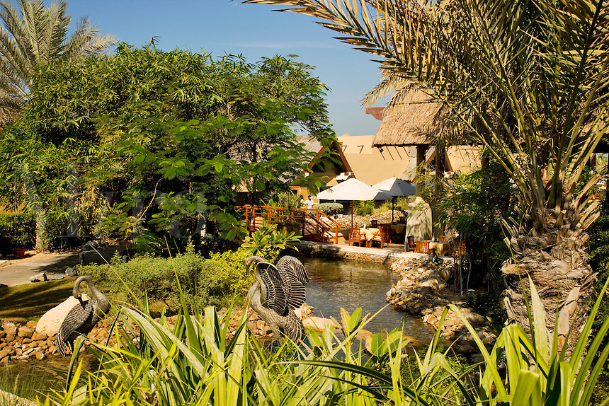 Dubai.  Gardens and pond at exclusive villa development, Beit al Bahar, attached to Jumeirah Beach Hotel..