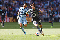 ST. PAUL, MN - AUGUST 21: Adrien Hunou #23 of Minnesota United FC with the ball in front of Roger Espinoza #15 of Sporting Kansas City during a game between Sporting Kansas City and Minnesota United FC at Allianz Field on August 21, 2021 in St. Paul, Minnesota.