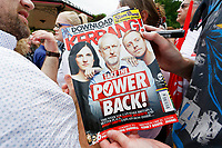 Pictured: A Labour party supporter holds a Kerrang magazine issue which has party leader Jeremy Corbyn on its front cover. Sunday 01 July 2018<br /> Re: Labour Party leader Jeremy Corbyn at the celebration for the 70 years since the National Health Service (NHS) was founded by Aneurin Bevan, Bedwellty Park, Tredegar, Wales, UK.