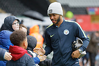 Raheem Sterling of Manchester City greets young fans as he arrives during the English Emirates FA Cup soccer match between Swansea City and Manchester City at the Liberty Stadium, Swansea, Wales, Britain, 16 March 2019. EPA/DIMITRIS LEGAKIS <br /> EDITORIAL USE ONLY. No use with unauthorized audio, video, data, fixture lists, club/league logos or 'live' services. Online in-match use limited to 75 images, no video emulation. No use in betting, games or single club/league/player publications