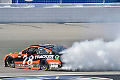 2017 Monster Energy NASCAR Cup Series - Kobalt 400<br /> Las Vegas Motor Speedway - Las Vegas, NV USA<br /> Sunday 12 March 2017<br /> Martin Truex Jr, Bass Pro Shops/TRACKER BOATS Toyota Camry celebrates his win with a burnout<br /> World Copyright: Nigel Kinrade/LAT Images<br /> ref: Digital Image 17LAS1nk07762
