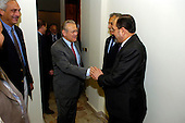 Prime Minister-designate Jawad al-Maliki of Iraq (right) greets United States Secretary of Defense Donald H. Rumsfeld (left) as they meet in Baghdad, Iraq, on April 26, 2006, as US Ambassador to Iraq Zalmay Khalilzad (center) looks on.  Rumsfeld and US Secretary of State Condoleezza Rice made an unannounced visit to Iraq to meet jointly with al-Maliki to show support for the continuing process of building a new Iraqi government.  Rumsfeld is also meeting with senior military leaders and the troops while in Iraq.  <br /> Mandatory Credit: Chad J. McNeeley / DoD via CNP