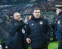 Pictured: Olympiakos' Kostas Karapaps and manager Oscar Garcia in the Toumba Stadium in Thessaloniki, Greece. Sunday 25 February 2018<br /> Re: Sunday's Greek Super League derby between PAOK Thessaloniki and Olympiakos was called off after Olympiakos' manager Oscar Garcia was struck in the face by an object believed to be a till machine paper roll, thrown by a spectator minutes before kick-off.<br /> Garcia left Toumba Stadium for a local hospital to seek treatment for a bloodied lip.<br /> The incident prompted the Olympiakos team to leave the pitch in protest before riots erupted outside the ground.<br /> Angry PAOK fans leaving the stadium then clashed with police who used tear gas to quell the violence.