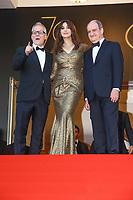 Thierry Fremeaux, Monica Bellucci et Pierre Lescure sur le tapis rouge pour la soirée dans le cadre de la journée anniversaire de la 70e édition du Festival du Film à Cannes, Palais des Festivals et des Congres, Cannes, Sud de la France, mardi 23 mai 2017.