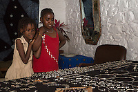 Young Girls Admiring the Silver Jewelry of Tuareg Silversmith Adam Zidia, Goree Island, Senegal