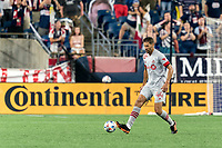 FOXBOROUGH, MA - JULY 7: Omar Gonzalez #44 of Toronto FC passes the ball during a game between Toronto FC and New England Revolution at Gillette Stadium on July 7, 2021 in Foxborough, Massachusetts.