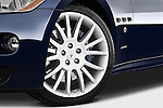 Tire and wheel close up detail view of a 2010 Maserati Granturismo S Automatic Coupe